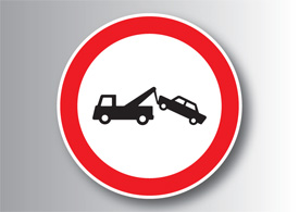Warning tow away sign